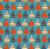 Holiday seamless pattern with sacks of gifts. Template for cartoons, crafts, surface textures, web pages backgrounds Royalty Free Stock Images