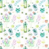 Holiday seamless pattern with watercolor gift boxes, air balloons, wine bottles, wine glasses and floral elemnts. In green and blue shadows, hand painted on a Stock Image