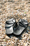 Holiday at the seaside - flip-flops on beach Stock Photos