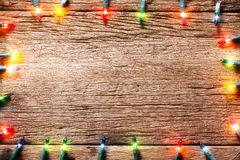 Holiday season  light decorations on wood texture Royalty Free Stock Photography
