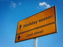 Holiday season road sign background sky. Royalty Free Stock Photo