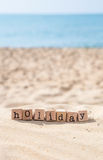 Holiday season word and sunny beach background Royalty Free Stock Photography