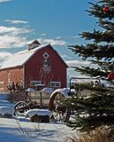 Holiday Setting. This image of the decorated tree, wagon and all American barn was taken in western MT Stock Image