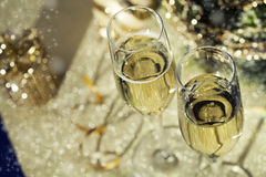 Holiday setup with sparkling wine in flute glasses and Christmas. Decorations Royalty Free Stock Image