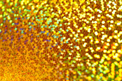 Holiday shiny blurry very bright gold background. Macro Stock Photos