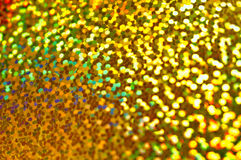 Holiday shiny blurry very bright gold background. Macro Stock Image