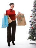 Holiday Shopping. Young woman with bags of gifts Royalty Free Stock Photos