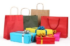 Holiday shopping bags and gift boxes. On white background royalty free stock photo