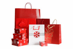 Holiday shopping bags and gift boxes on white. Various sizes of holiday shopping bags and gift boxes on white background stock photos