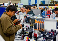Holiday shopping on Black Friday. Brownsville, Texas --- Nov 27, 2009.  Consumers are shopping for cameras in an electronic retailer store on Black Friday sale Royalty Free Stock Photo