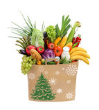 Holiday shopping, Christmas bag full foods Royalty Free Stock Image