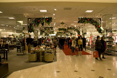 Holiday shopping department store. Customers were enjoying holiday shopping in Nordstrom department store stock image
