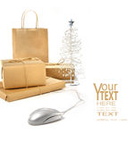 Holiday shopping done by the click of a mouse. On the internet royalty free stock photography