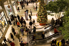 Holiday shopping mall. A shopping mall with Christmas decorations filled with customers  on Friday night. (Bellevue Square, Bellevue, Washington, USA Stock Photography