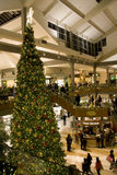 Holiday shopping mall. A shopping mall with Christmas decorations filled with customers  on Friday night. (Bellevue Square, Bellevue, Washington, USA Royalty Free Stock Photo