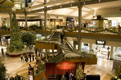 Holiday shopping mall. A shopping mall with Christmas decorations filled with customers  on Friday night. (Bellevue Square, Bellevue, Washington, USA Royalty Free Stock Photos