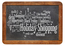 Holiday shopping word cloud. Consumerism concept - holiday shopping word cloud on a vintage slate blackboard isolated on white royalty free stock photography