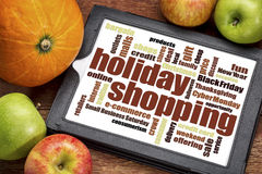 Holiday shopping word cloud on tablet Stock Image