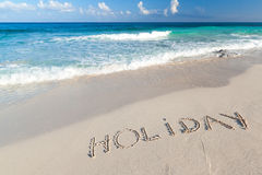 Holiday sign on the beach of Caribbean Sea. In Mexico Stock Images
