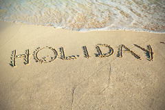 Holiday sign on the beach of Caribbean Sea. In Mexico Stock Photo