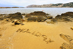 Holiday sign on the beach sand Stock Photos