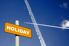 Holiday sign with jet trails in a dark blue sky Royalty Free Stock Photo