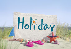 Holiday Signboard and Summer Props on Beach Stock Photography