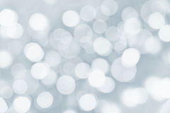 Holiday silver background with blurred lights Royalty Free Stock Photography
