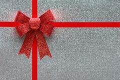 Holiday silver background with red ribbon Royalty Free Stock Photo