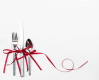 Holiday Silverware with Red Ribbon Stock Image