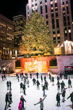 Holiday Skating by the Tree royalty free stock photos