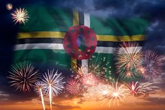 Fireworks and flag of Dominica. Holiday sky with fireworks and flag of Dominica, independence day royalty free stock photography