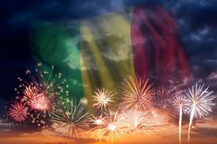 Fireworks and flag of Mali. Holiday sky with fireworks and flag of Mali, independence day Royalty Free Stock Photos