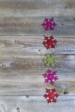 Holiday Snowflake Shaped Ornaments on Weathered Wood Royalty Free Stock Photography