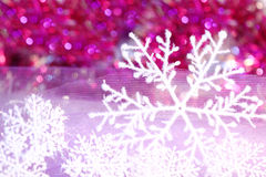 Holiday snowflake on violet background Royalty Free Stock Image