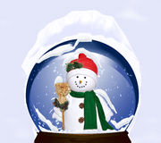 Holiday snowman and snow globe Stock Images