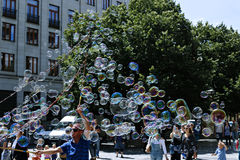 Holiday soap bubbles in the street in Prague Royalty Free Stock Photos
