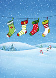 Christmas stockings illustration. Christmas Holiday watercolor illustration of a landscape with socks hanging on a rope, hills and sweets Stock Photos