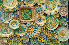Holiday souvenirs on the wall. Patterned plates Stock Image
