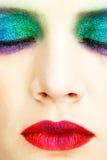 Holiday spangled eye makeup. Shining holiday spangled female eye makeup Royalty Free Stock Images