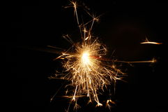 Holiday sparkler. Isolated on black background with copyspace Stock Photos