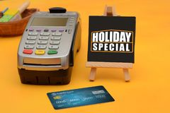 Holiday Special sale sign with credit card swipe machine.  Stock Image