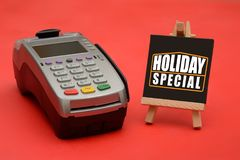 Holiday Special sale sign with credit card swipe machine.  Stock Images