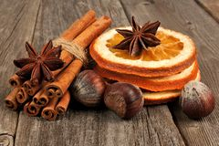 Holiday spices and aromatics on rustic wood Stock Images