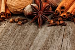 Holiday spices and baking ingredients close up on rustic wood Stock Image
