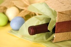 Holiday Spirit. Holiday still life of wine and eggs in gift bag Royalty Free Stock Photography