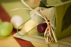 Holiday Spirit. Holiday still life with wine and easter eggs Royalty Free Stock Photos