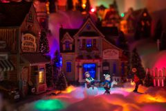 Christmas scenery concept with kids happy playing in snow in the stock photo