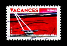 Holiday Stamps- Red boat, rope and cleat, Holidays serie, circa. MOSCOW, RUSSIA - MARCH 18, 2018: A stamp printed in France shows Holiday Stamps- Red boat, rope royalty free stock photo