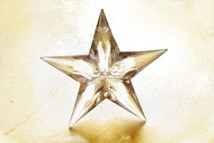 Holiday star. Holiday star on golden background Stock Images